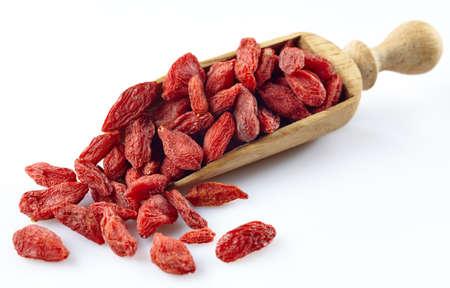 goji: Wooden scoop of dried goji berries
