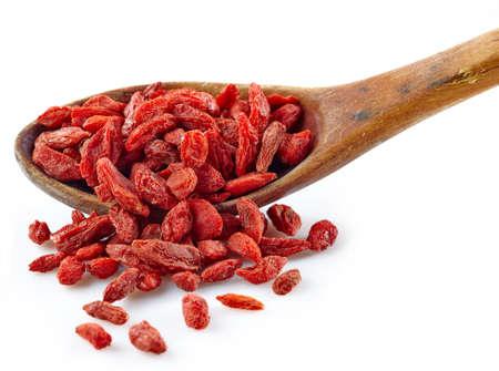 goji: Wooden spoon of dried goji berries