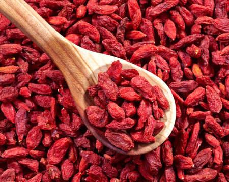Spoon of dried goji berries photo