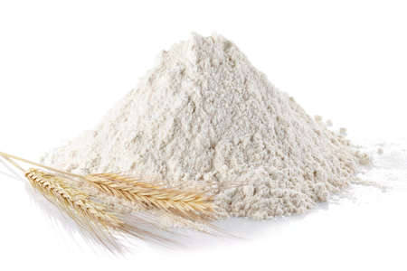 wheat flour: Heap of wheat flour and wheat ears on isolated white