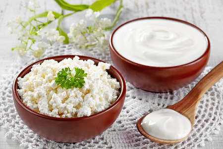 Bowl of fresh cottage cheese and sour cream Stok Fotoğraf - 24545567