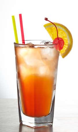 grenadine: Orange cocktail with straws decorated with slice of orange and cherry Stock Photo