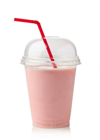 Glass of strawberry milkshake on white background Imagens