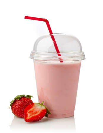 Glass of strawberry milkshake on white background Stock Photo