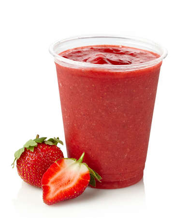 Glass of strawberry smoothie on white background