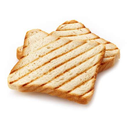 Dos rebanadas de pan tostado aislados en blanco