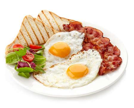 기름에 튀긴 된 계란, 베이컨, 토스트와 아침 식사의 플레이트