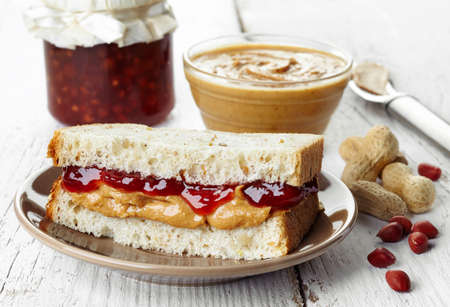 Peanut butter and strawberry jelly sandwich photo