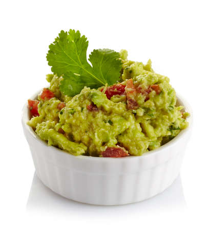tex mex: White bowl of fresh guacamole dip isolated on white background Stock Photo