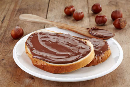 hazelnuts: Bread with chocolate cream and hazelnuts Stock Photo