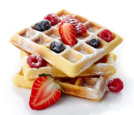 breakfast food: Belgium waffles with fresh berries and caster sugar isolated on white  Stock Photo