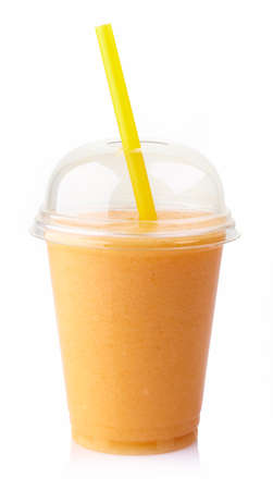 plastic: Glass of fresh mango smoothie isolated on white background