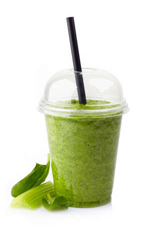 Glass of healthy green vegetable smoothie isolated on white background photo