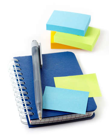 Notebook, pen and post-it notes isolated on white background photo