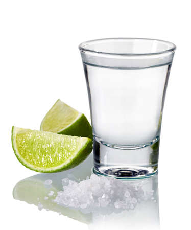 Tequila shot with fresh lime and salt isolated on white background Stock Photo