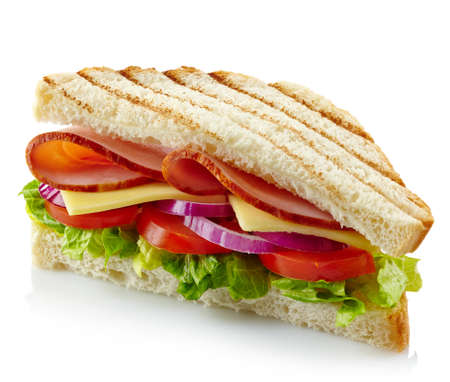 Sandwich with ham, cheese and fresh vegetables isolated on white background photo