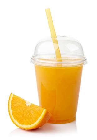 白い背景上に分離されて新鮮なオレンジ ジュースのガラスを奪う 写真素材