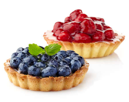 Two berry tarts isolated on white background
