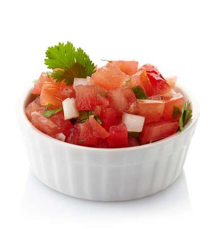 Bowl of fresh salsa dip isolated on white background Фото со стока