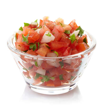 glass of bowl: Bowl of fresh salsa dip isolated on white background Stock Photo
