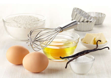 baking cake: Ingredients for baking cake on white wooden background Stock Photo