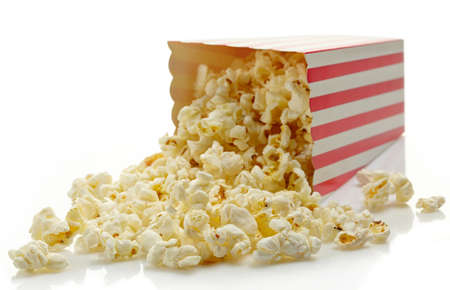Striped box of popcorn isolated on white background photo