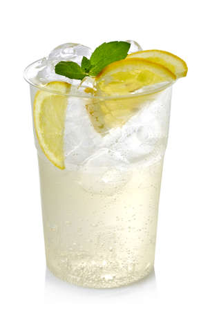 Plastic glass of lemon lemonade with ice and lemon slices isolated on white background