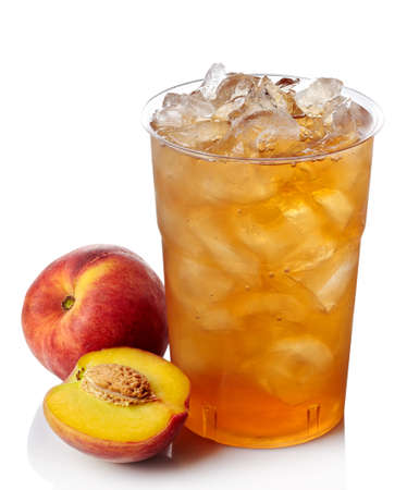 Plastic glass of peach ice tea isolated on white background photo