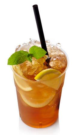 Plastic glass of lemon ice tea isolated on white background