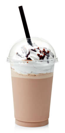 Chocolate milkshake covered with whipped cream in plastic glass isolated on white background 스톡 콘텐츠
