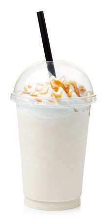 Vanilla milkshake covered with whipped cream in plastic glass isolated on white background 스톡 콘텐츠