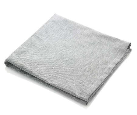 Gevouwen grijze katoen servet geïsoleerd op een witte achtergrond Stockfoto