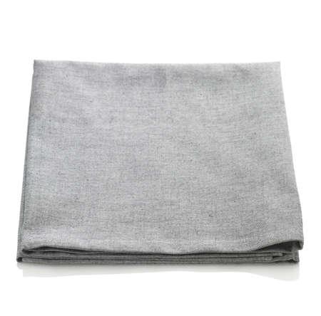 serviette: Doblado la servilleta de algodón gris aislado en el fondo blanco