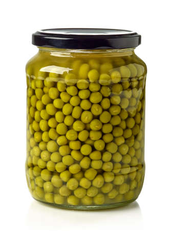 canned peas: Jar of canned green peas isolated on white background
