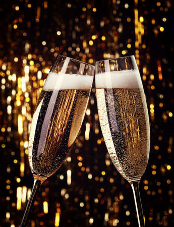 champagne flutes: Two flutes of champagne on bokeh background