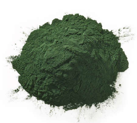 plant antioxidants: Stack of spirulina algae powder isolated on white background Stock Photo