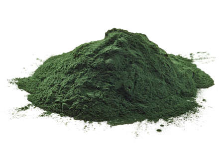 Stack of spirulina algae powder isolated on white background Imagens