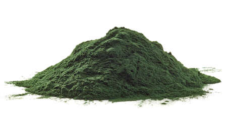 Stack of spirulina algae powder isolated on white background Foto de archivo