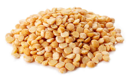 Heap of yellow dry split peas isolated on white background