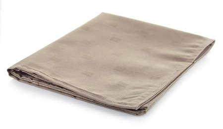 Katoenen servet geïsoleerd op een witte achtergrond