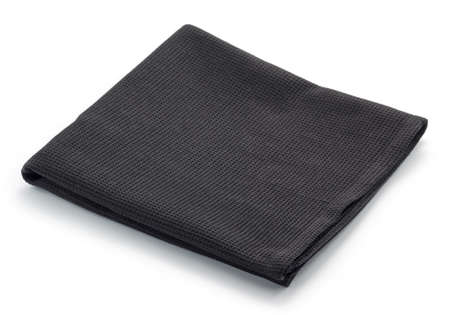 Folded black cotton napkin isolated on white background