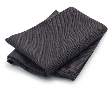 dishcloth: Folded black cotton napkin isolated on white background