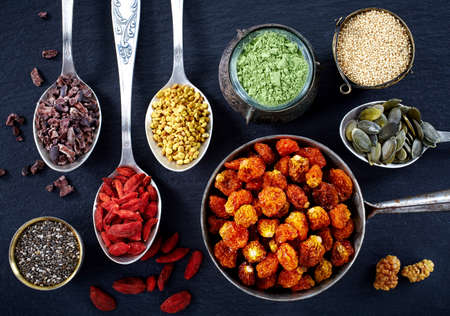 Various superfoods on black background Stock Photo