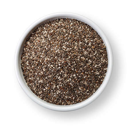 White bowl of chia seeds isolated on white background Stock Photo