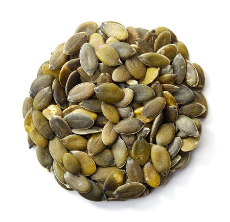 pumpkin seeds: Circle of pumpkin seeds isolated on white background