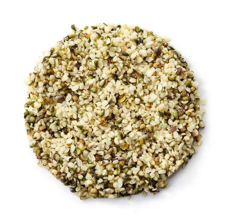 Circle of shelled hemp seeds isolated on white background