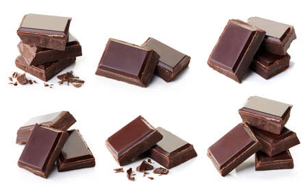Collection of various dark chocolate pieces isolated on white background Imagens