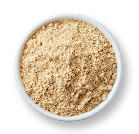 dry powder: White bowl of maca powder isolated on white background