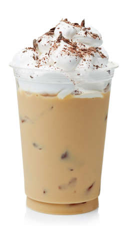 Iced coffee covered with whipped cream in plastic glass isolated on white background Foto de archivo
