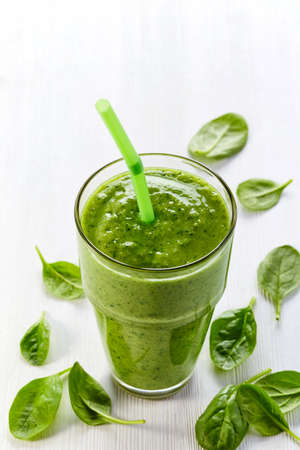 Glass of healthy green spinach smoothie